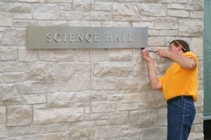 Science Hall signs have been taken down to make way for the building's new name.
