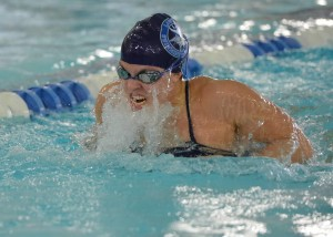 Lawrence's Hayley Cardinal won the 100-yard breaststroke on Saturday at the Midwest Conference Championships.