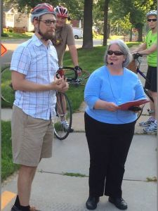 "Antoinette (pictured here with Nick Hoffman) talks about the Cleggett-Hollensworth family during the ""Bicycling Through Local Black History"" tour."