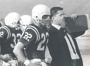 Ron Roberts, right, shouts instructions to the field while being flanked by All-America quarterback Chuck McKee '68.
