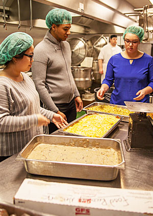 Food for Fox founders Shang Li (l.), Macolm Lunn-Craft (c.) and Rachel Gregory (r.) are using surplus food from Lawrence to help feed others in the community.