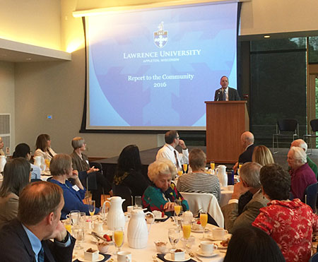 A photo of Lawrence University President Mark Burstein addresses a crowd of community leaders at the university's 2016 Report to the Community.