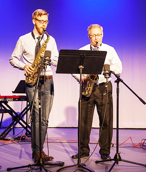 A photo of Lawrence University faculty saxophonists Sumner Truax and Steven Jordheim playing saxophones on Lawrence Giving Day in 2015.