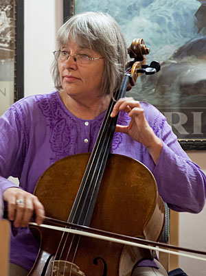 A photo of Lawrence University cello professor Janet Anthony playing her cello.
