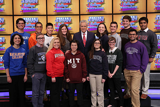 A photo of Lawrence University student Allison Holley and her competitors from 14 colleges with Jeopardy host Alex Trebek.