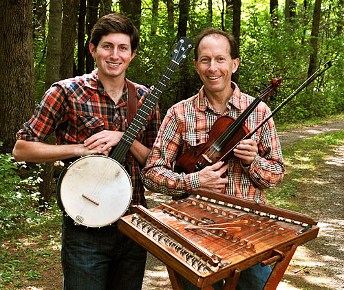 A photo of Lawrence University graduate Ken Kolodner and his son Brad with their instruments.