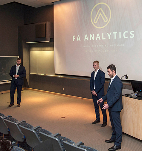Photo of Mattias Soederqvist, Felix Henriksson and Ryan Eardley making a presentation at the LaunchLU contest.