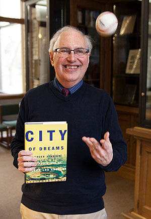 "Lawrece Professor Jerald Podair with a copy of his latest book ""City of Dreams"""