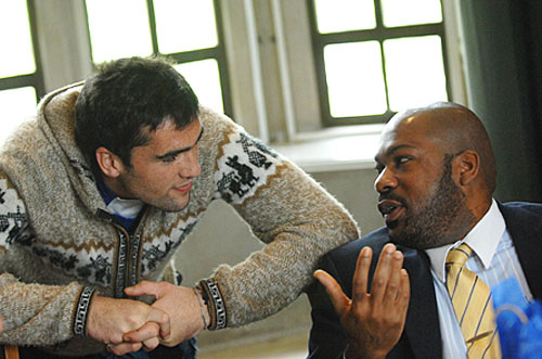 Photo of Christopher Card speaking with a student