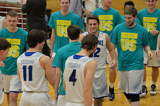 "A photo of members of the men's basketball team wearing ""It's on Us"" t-shirts"