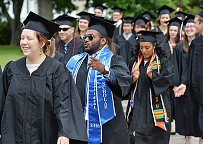 Photo of procession of graduating Lawrence seniors