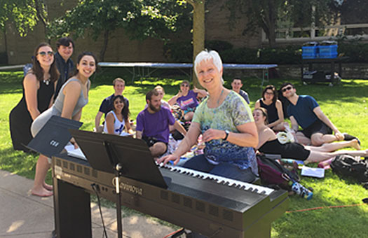Bonnie Koestner outside with her students