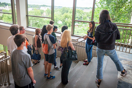 Student leading a campus tour in the Warch Campus Center