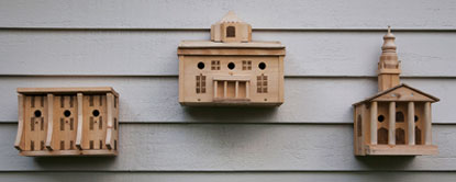 A series of three bird houses modeled after Lawrence University buildings.