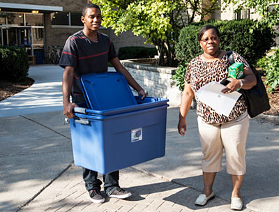 Mother helping son move into the dorm