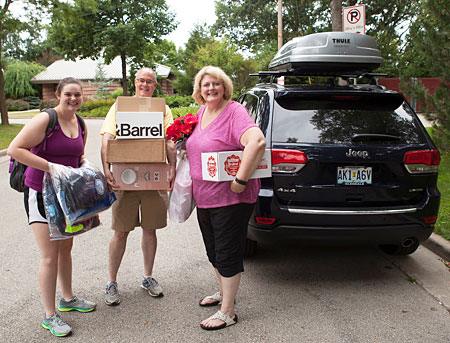 Student and parents unloading their car for new student move-in day