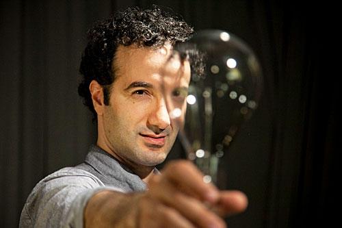 Jad Abumrad holding a light bulb