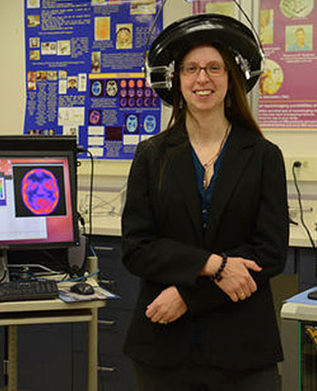 Julie Brefczynski-Lewis wearing PET scanner on her head