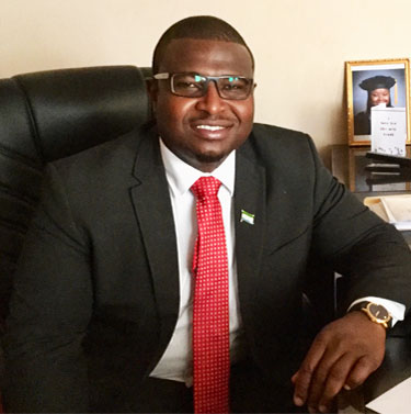 Momodu Magligi sitting in his office