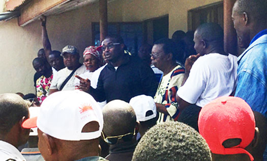 Momodu Magligi giving a speech on a campaign stop