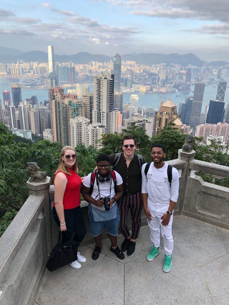Group of Lawrence students with Hong Kong skyline in background
