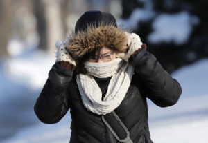 Student Celeste Reyes crosses College Avenue in the cold weather.