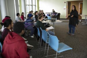 Professor Lori Hilt talks with students at Hiett Hall.