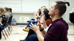 Students practice using American Sign Language