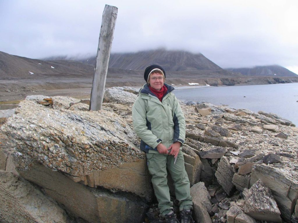 Marcia Bjornerud poses for a photo on rocks in Svalbard, arctic Norway.