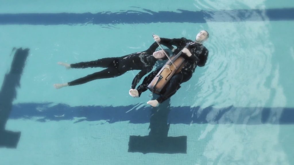 """Gabriel Forestieri and Loren Kiyoshi Dempster float in the water while performing """"Breathe."""""""