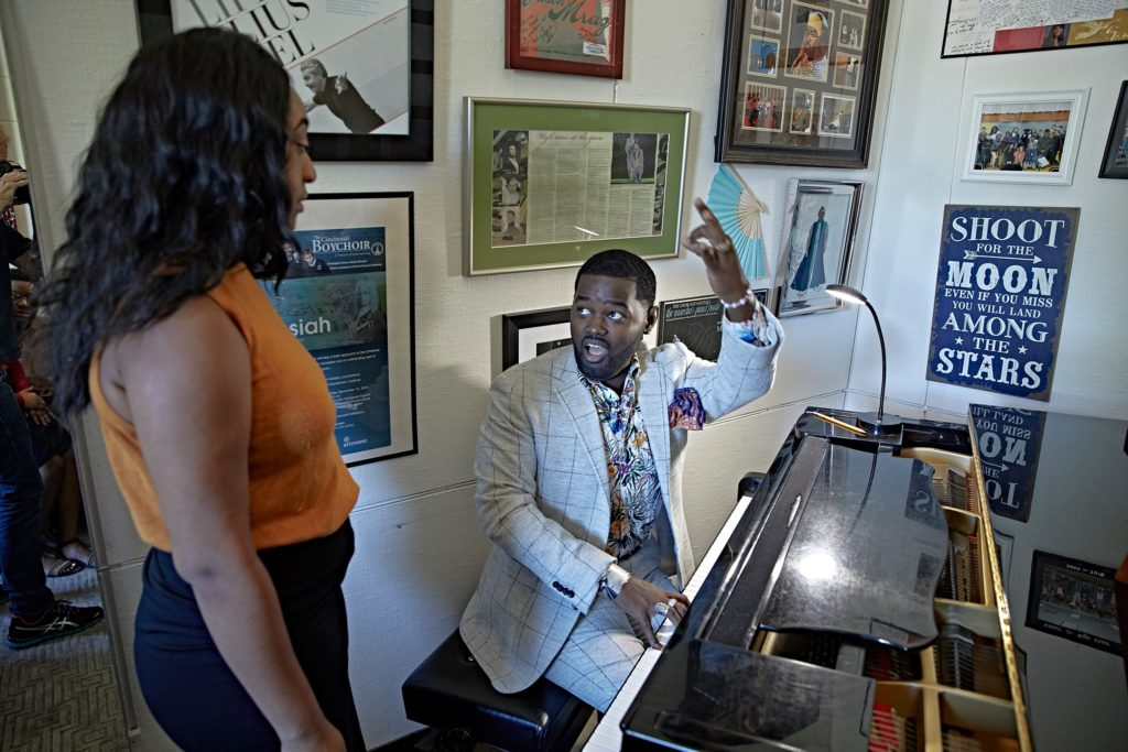 John Holiday works with a student in his voice studio.