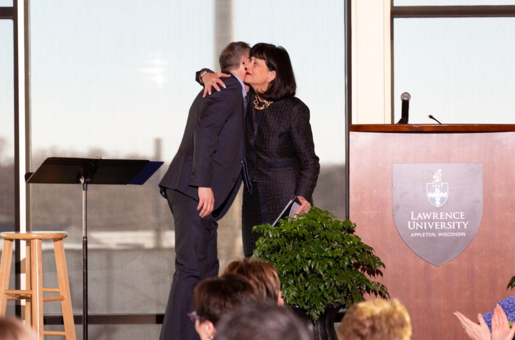 Mark Burstein hugs Cathie Tierney during Tuesday's Report to the Community.