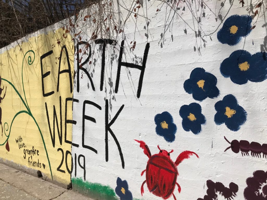 Wall along Drew Street is painted for Earth Week.