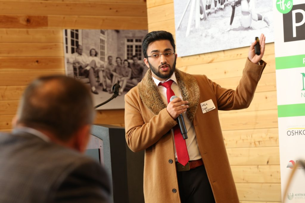Hamza Ehsan '20 delivers his pitch for EVSmart at Thursday's The Pitch at Titletown Tech in Green Bay.