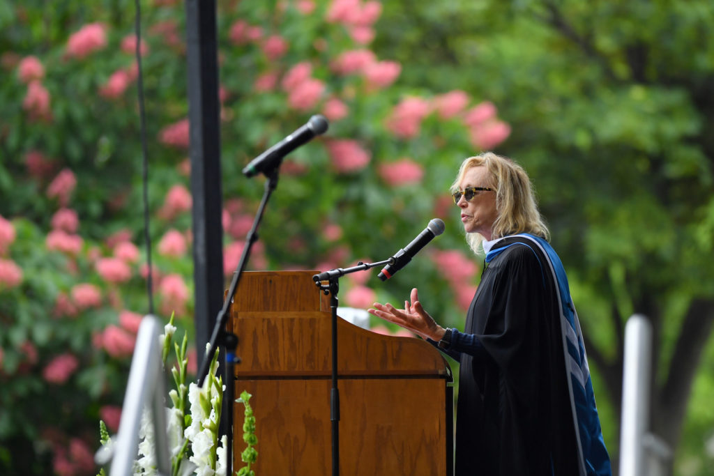 Lee Shallat Chemel, on stage, addresses the Lawrence graduates during her Commencement speech.