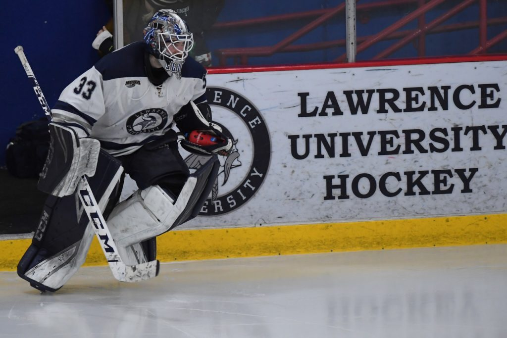 Photo shows Lawrence University Hockey signage at the ice arena in Appleton.