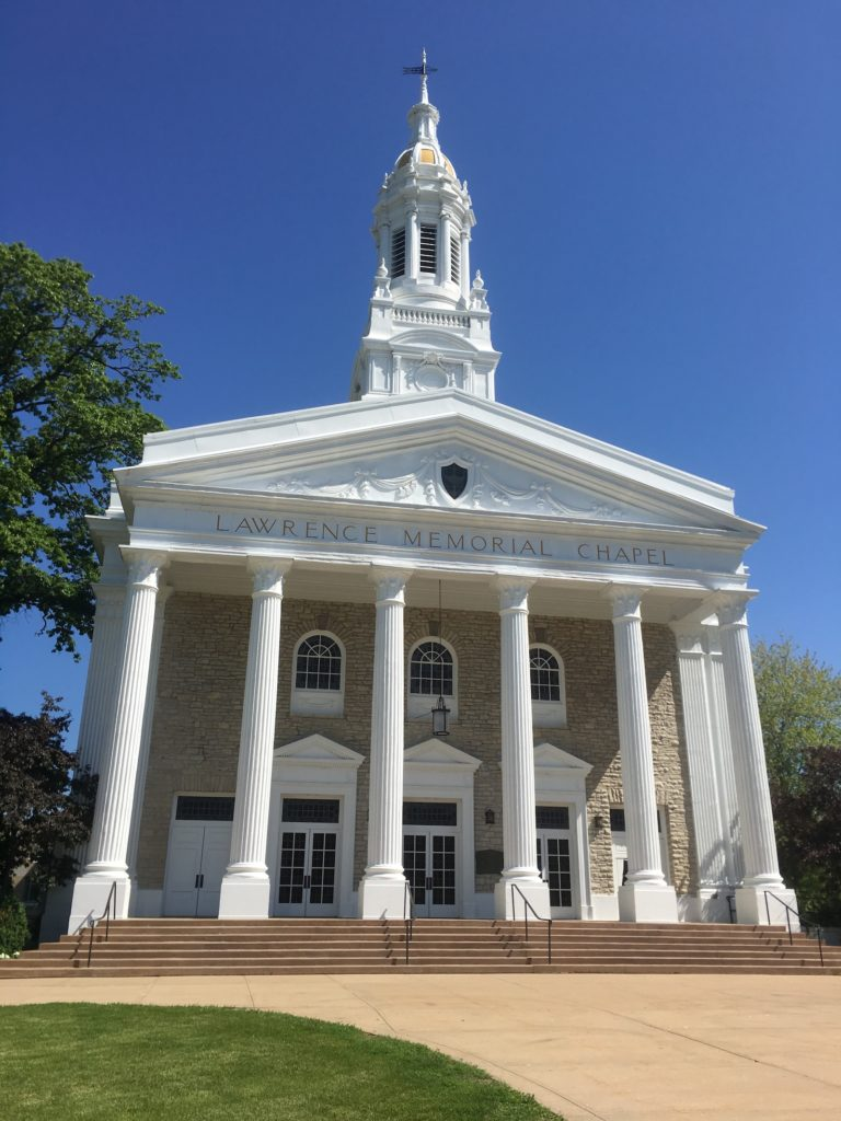 Photo of Memorial Chapel on a sunny day with green grass and blue sky.