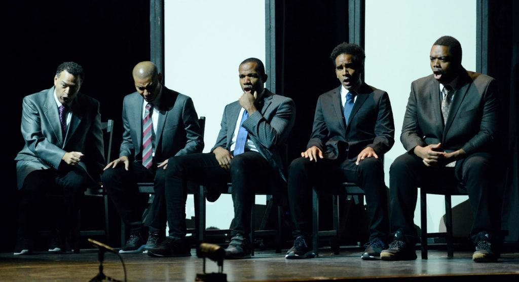 "Derrell Acon '14 sings on stage with the four other leads in ""The Central Park Five,"" an opera being performed by Long Beach Opera in southern California."