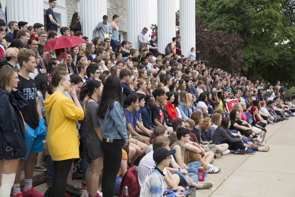 New students stand and sit on the stairs of Memorial Chapel before taking their class photo during Welcome Week.