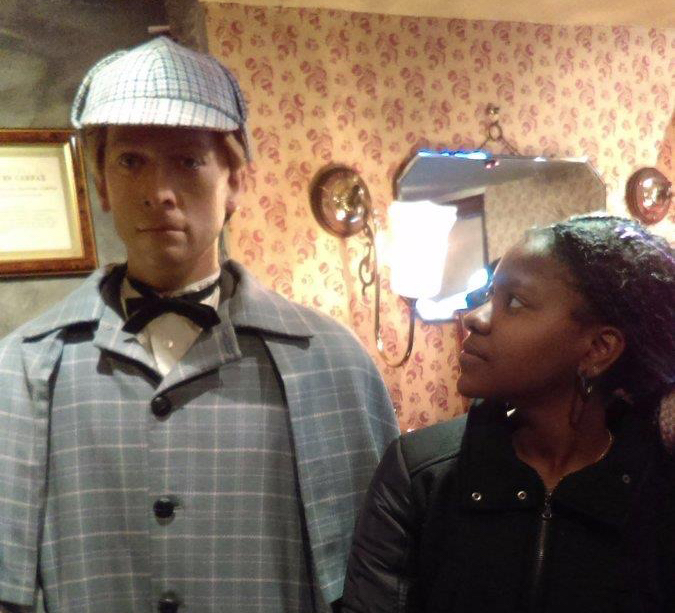 Tia Colbert looks up at a wax figure of Sherlock Holmes at the Sherlock Holmes Museum in London.
