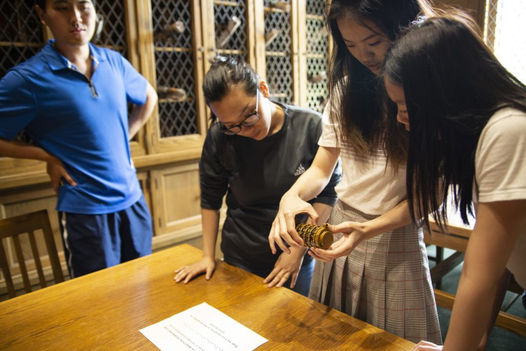 Students look through clues in an escape room in the Mudd Library.