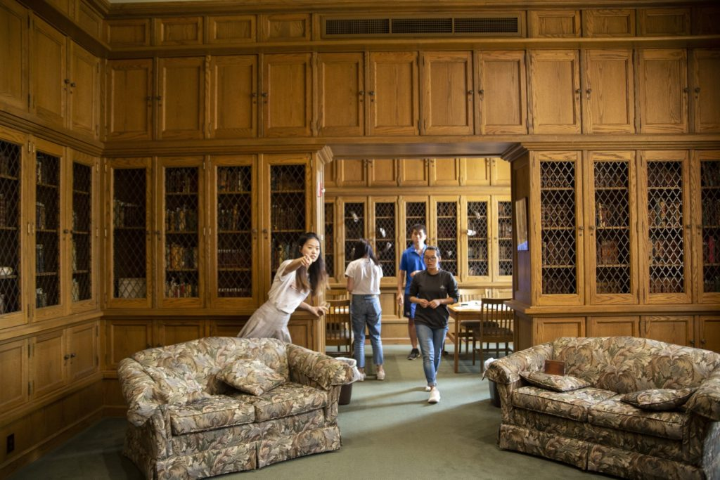 Students work to solve the escape room set up in the Mudd Library.