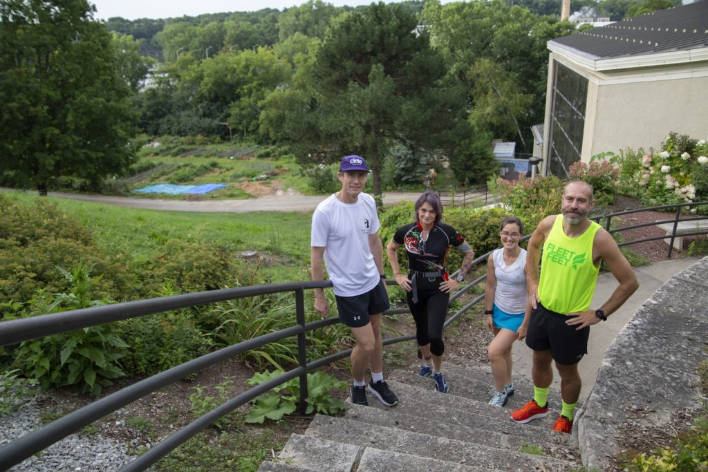 Douglas Martin, Megan Pickett, Relena Del Toro Ribbons, and Jason Brozek pose in their running gear on the Lawrence campus.
