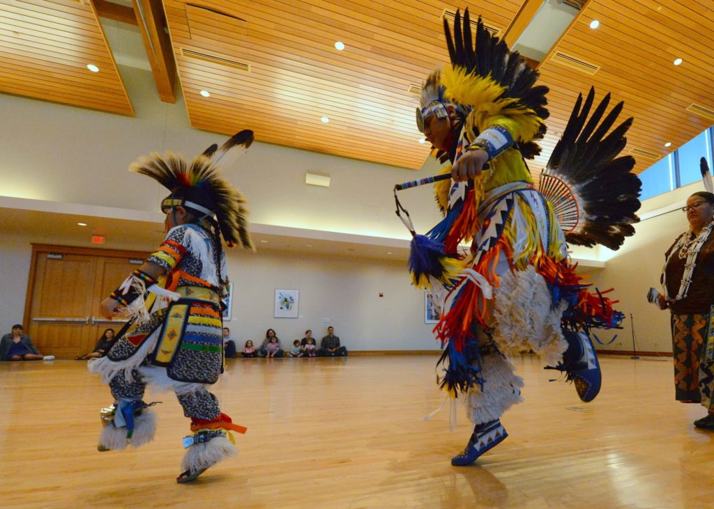 Dancers perform traditional Native American ceremony in Warch Campus Center on Indigenous Peoples Day.