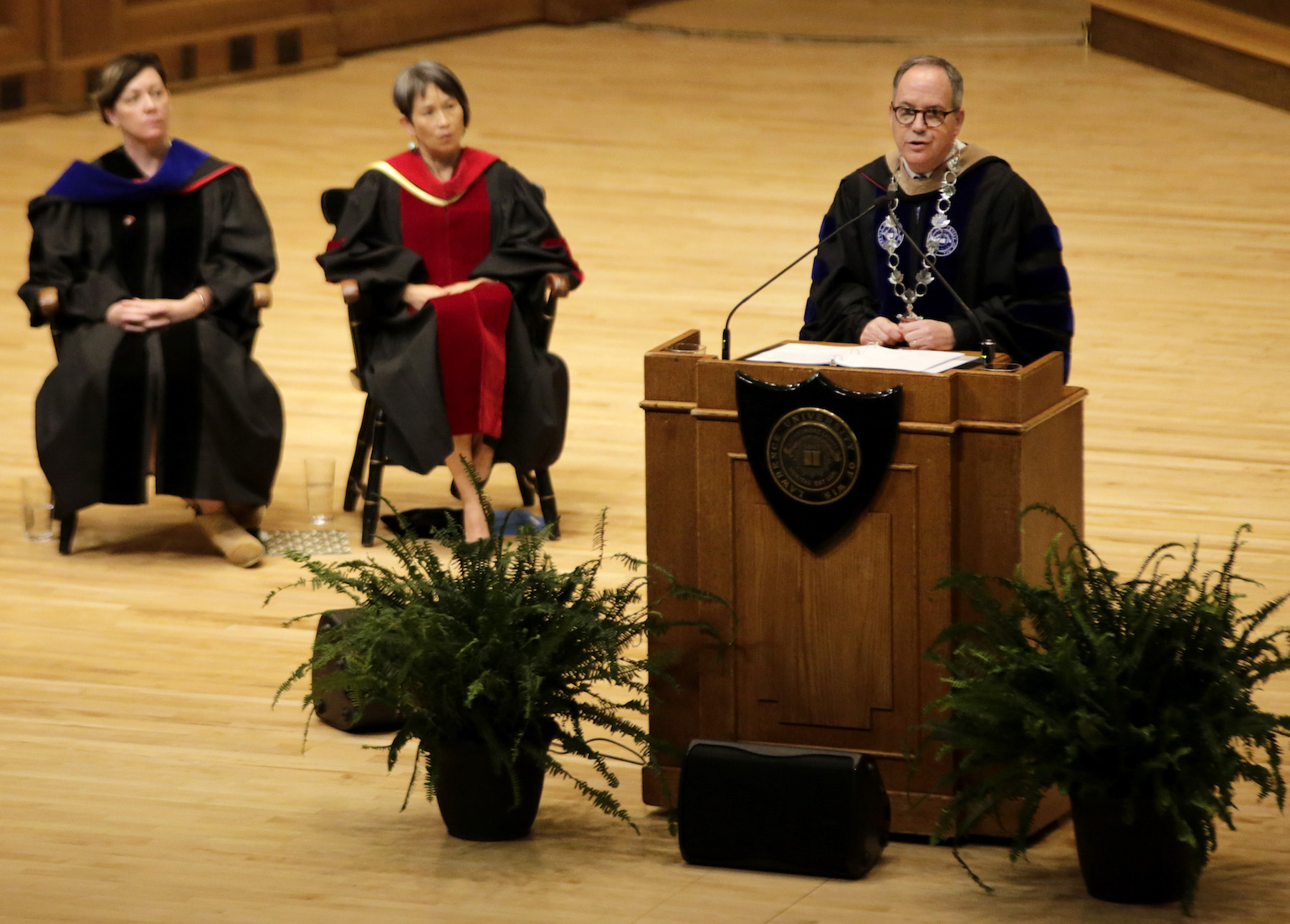 President Mark Burstein speaks at the podium from the stage of Memorial Chapel during Thursday's Matriculation Convocation.