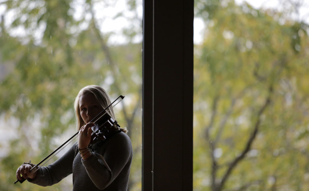 """A Lawrence student performs in """"Ten Thousand Birds"""" in the Warch Campus Center."""