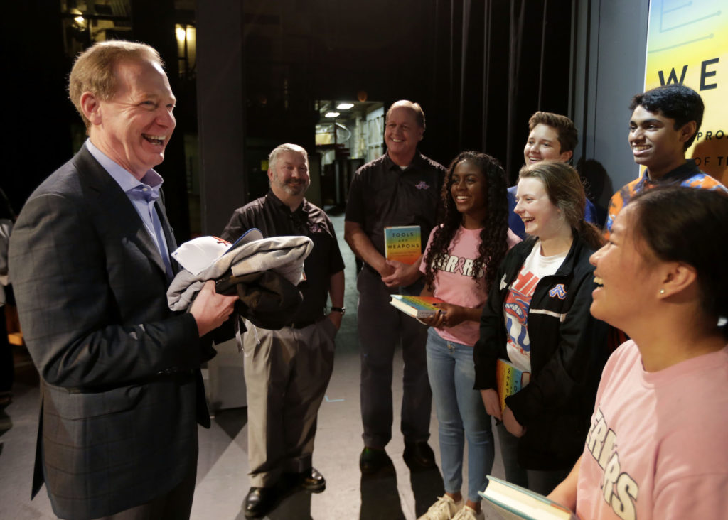 Brad Smith laughs with students from Appleton West High School on the Stansbury Theatre stage.