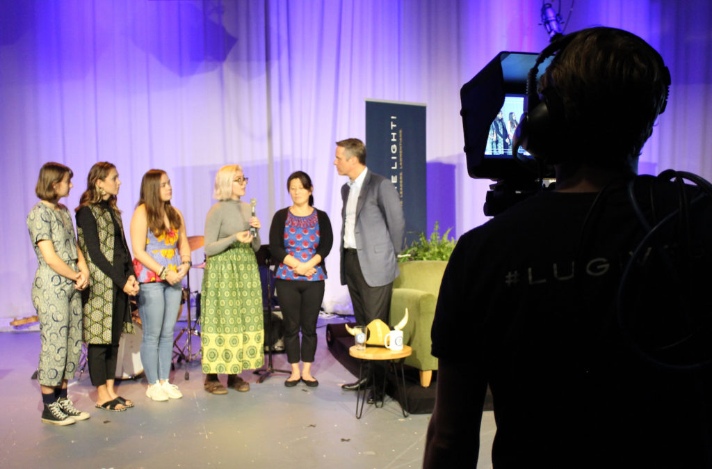 Terry Moran '82 interviews Dominica Chang (far right) and the four Lawrence University students who studied abroad in Senegal during the spring term.