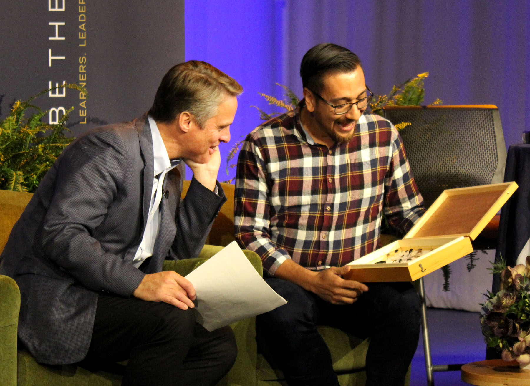 Terry Moran looks at a display of bees with biology professor Israel Del Toro on the set of the 2019 Giving Day webcast.