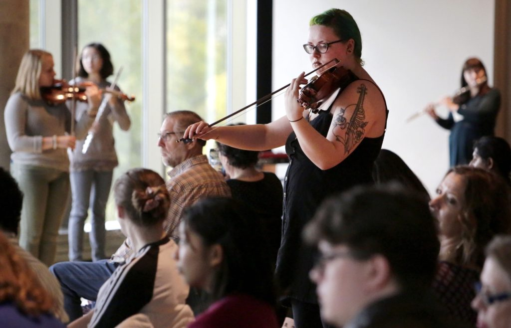 "Lawrence musicians perform amid the audience during the ""Ten Thousand Birds"" performance in the Warch Campus Center."